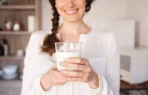 lady holding a glass of milk